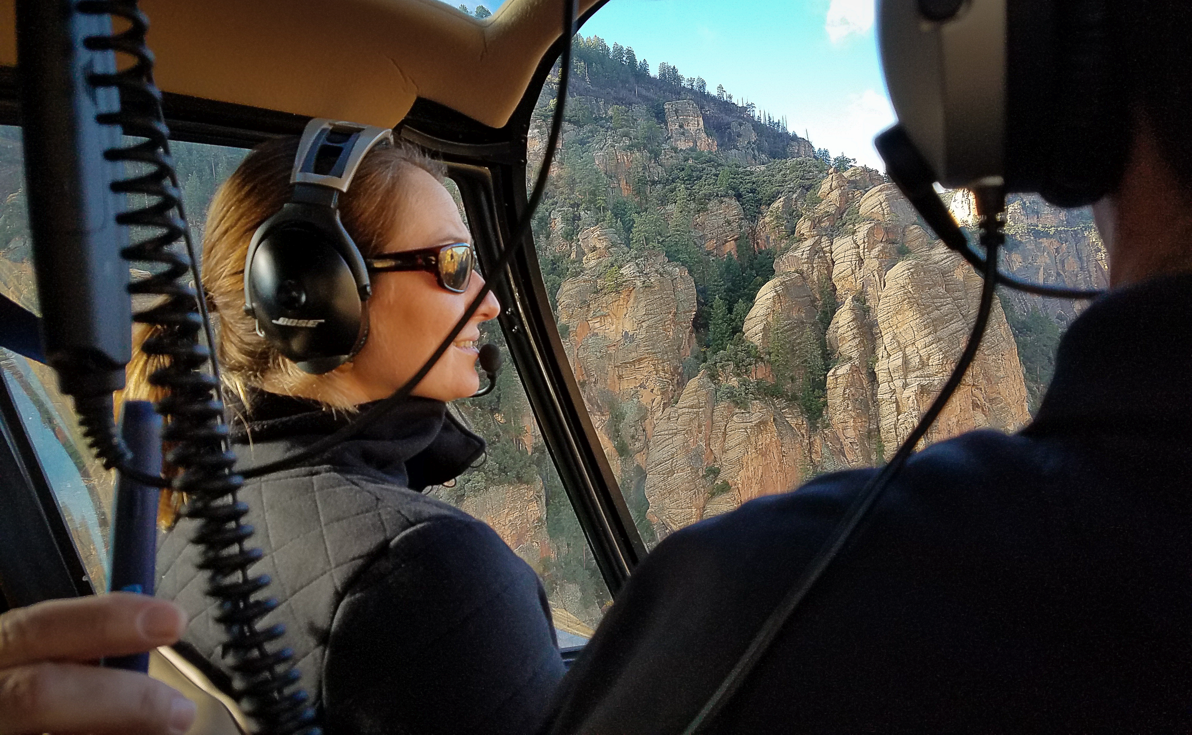 Guest Chelsea Taylor in flight aboard one of Guidance Air's Robinson R44 helicopters